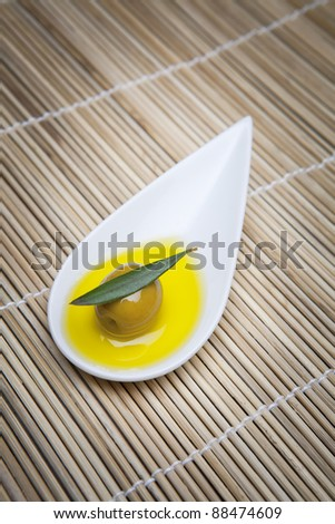 mouthful of green olive virgin olive oil