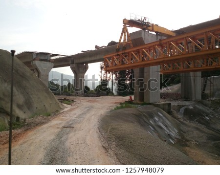 Movable Scaffolding System (MSS) the under slung launcher to construct span-by-span in-situ of bridges. The MSS system consists of a support structure spanning between two piers.