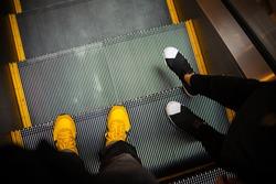 Move down the escalator.