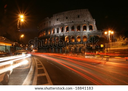 Movement of cars in front of the Coliseum in Rome