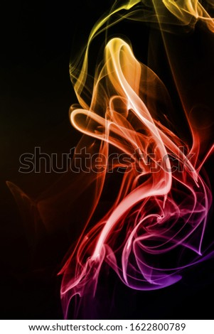 Movement of colorful smoke isolated on black background.