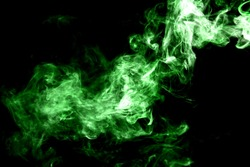 Movement of green smoke on black background.