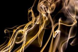 Movement of smoke,golden smoke background. Abstract of smoke on black background, smoke background ,gold smoke background