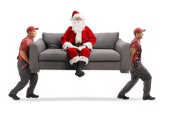 Movers carrying a sofa with santa claus sitting and looking at camera isolated on white background