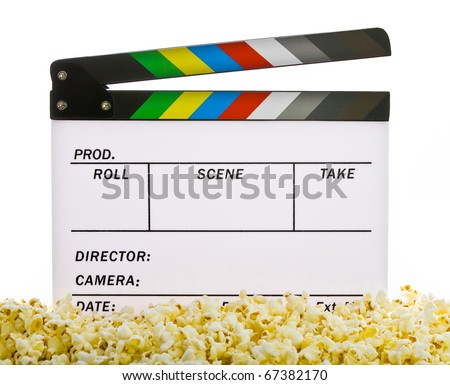 Movie Clapper Board in popcorn isolated on white
