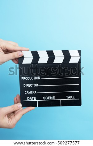 movie clapper on blue background, cinema concept #509277577