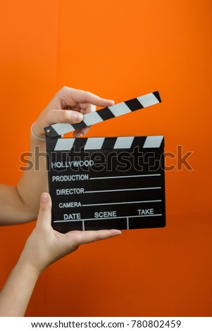 movie clapper on orange background, cinema concept #780802459
