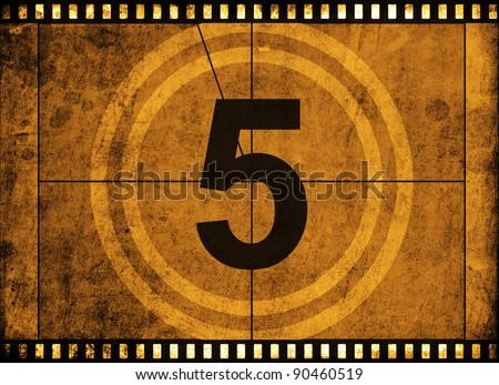 movie film strip with countdown number on grunge background - stock photo