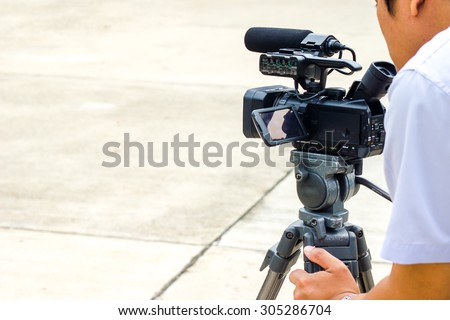 Movie making camera with cameraman