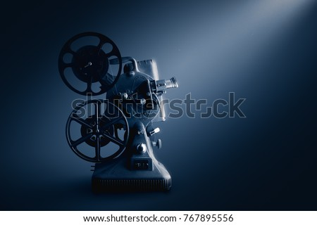 Movie projector on a dark background / high contrast image #767895556
