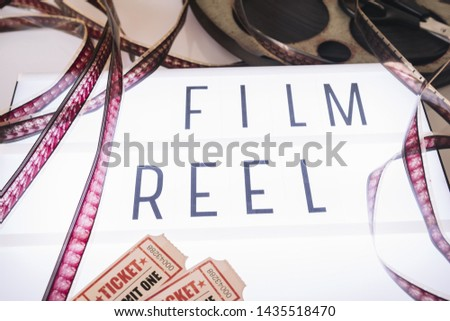 Movie sign with cinema reel #1435518470