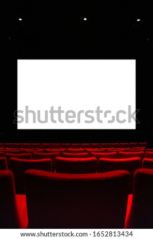 Movie theatre with empty armchairs and empty cinema curtain.