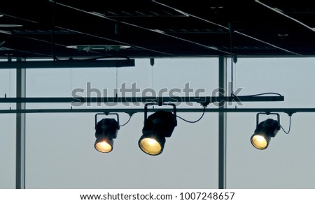 Moving accent spotlights on the rail system illuminates studio #1007248657