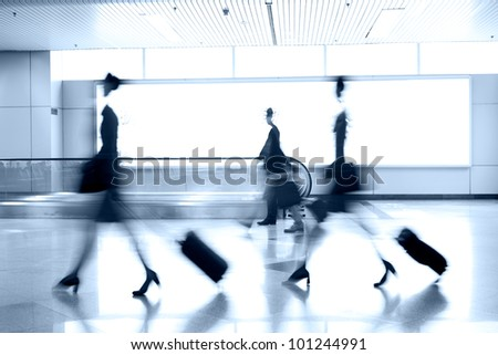 moving blur people in airport
