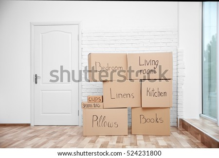 Moving boxes in room on light background #524231800