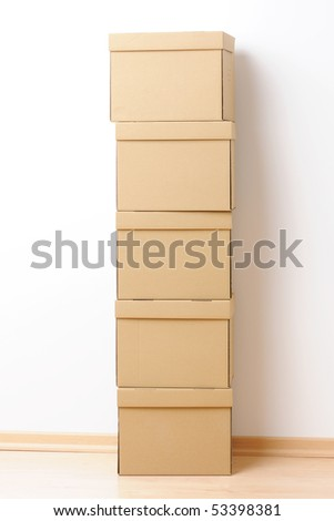 Moving boxes stacked in front of the wall