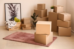 Moving boxes with belongings in empty room