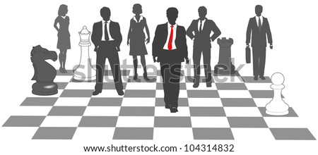 Moving business man leads team to win as pieces on chess board
