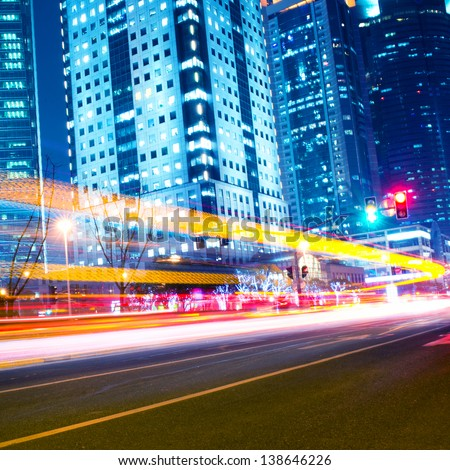 moving car with blur light through modern city at night.