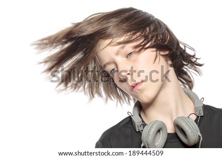 moving cool teenager boy with headphones, isolated on white.