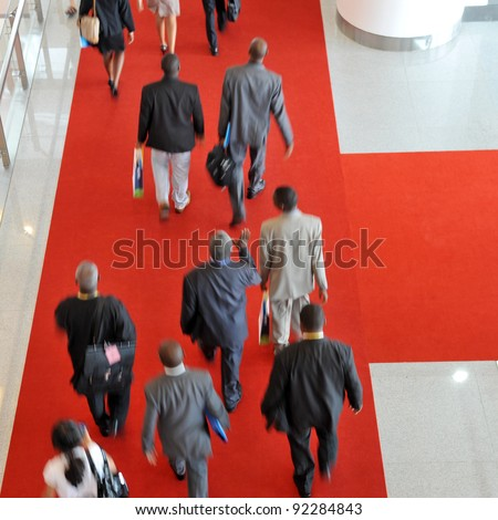 Moving crowd  in a international exhibition. motion blur