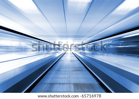 moving escalator in business center #65716978