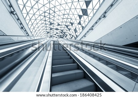 Stock Photo Moving escalator in the business center of a city