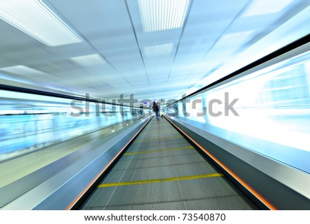 moving escalator with person