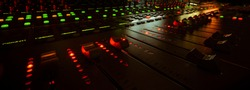 moving faders in a mixing console in a sound studio