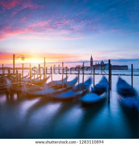 Moving gondola boats in harbor. Early morning with sunrise in Venice, Italy, Europe. #1283110894