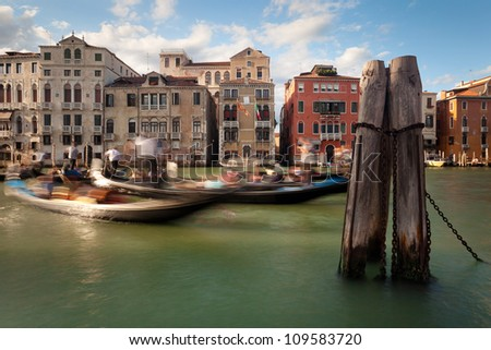 moving gondolas and gondoliers in venice grand canal, Italy, Europe