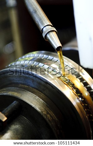 Moving oil in a machine, Factory operator - stock photo