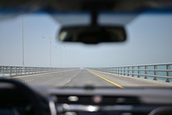 Moving on the road view from inside the car on the new bridge cross the sea in Kuwait.