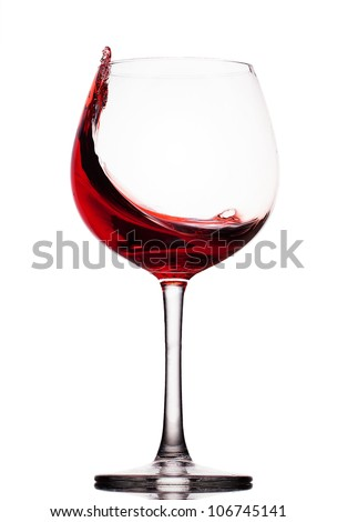 moving red wine glass over a white background #106745141