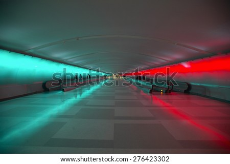 Moving sidewalks and a changing light show in the tunnel of the Detroit Airport, Detroit, Michigan #276423302