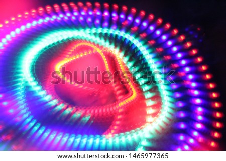 Moving, spinning led lights. Abstract idea of the atom's nucleus and orbiting electrons as an electron cloud.  #1465977365