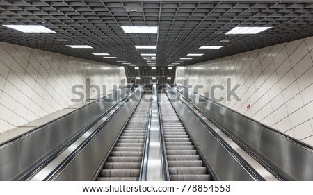 Stock Photo Moving stairs in underground.Escalator stairs in metro station.