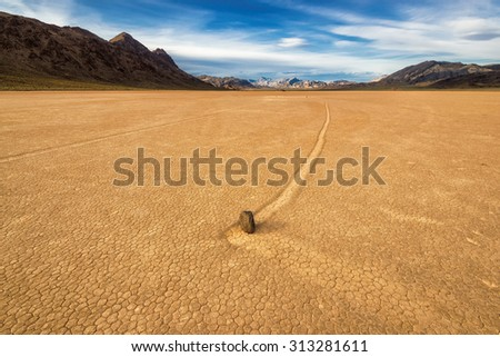 Moving stone in the desert of Death Valley national park, California