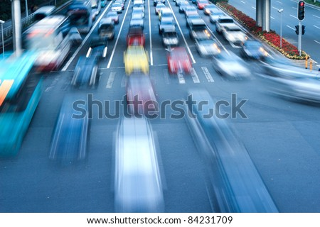 Moving traffic and car lights in the evening - stock photo