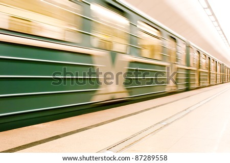 Moving train in underground - stock photo