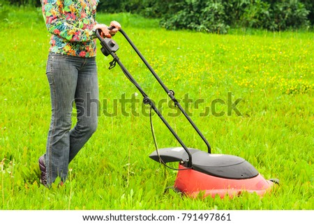 Mowing lawns, lawn mower on green grass #791497861