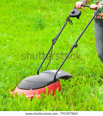 Mowing lawns, lawn mower on green grass #791497864