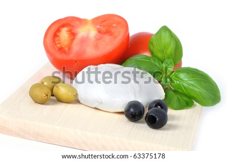 mozarella cheese with basil, tomato and olives isolated on white background.