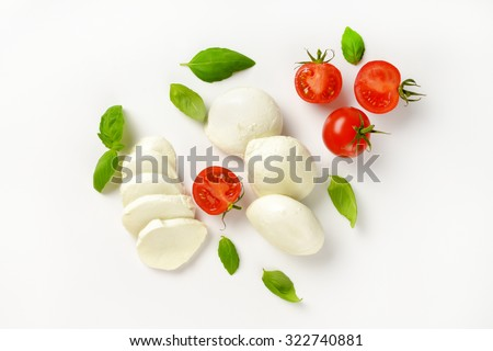 mozzarella, cherry tomatoes and fresh basil - ingredients for caprese salad