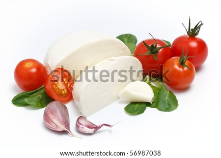 Mozzarella, lettuce and garlic on white background