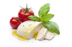 Mozzarella with tomatos and basil leaves isolated