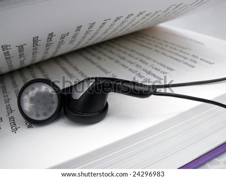 mp3 player ear buds and reading book
