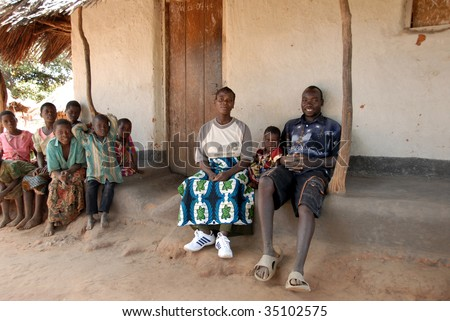 MPHANDULA, MALAWI – CIRCA MAY 2007 : Yohan David (R) relaxes in front of a house May 2007 in Mphandula, Malawi. David's son was adopted by singer Madonna.