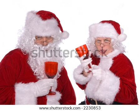 Mr. and Mrs. Claus are celebrating a good delivery with a few drinks