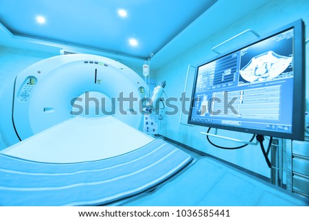 MRI scanner room take with art lighting and blue filter